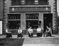 Ray St. Martin, Herb Oslund, Frank Arver, Howard Cress and Charles Bell with their camera equipment in front of Ray-Bell Films.